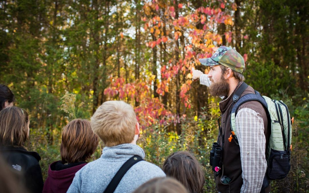 Ridge and Valley Charter School Guide with students on a nature walk